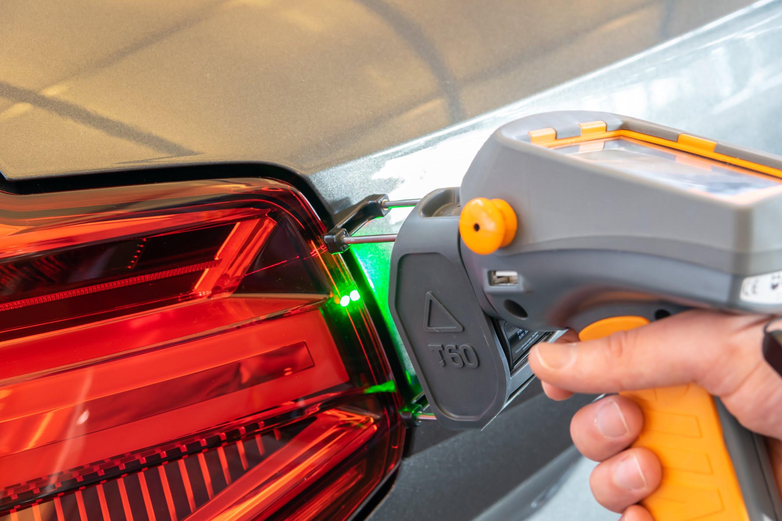 GapGun Pro2 being used on a car headlight